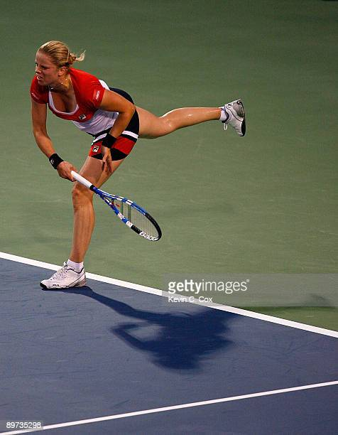 Kim Clijsters of Belgium serves to Marion Bartoli of France during Day 1 of the Western Southern Financial Group Women's Open on August 10 2009 at...