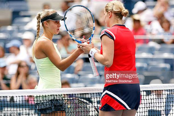 Kim Clijsters of Belgium shakes hands with Viktoriya Kutuzova of Ukraine after defeating her during day one of the 2009 US Open at the USTA Billie...