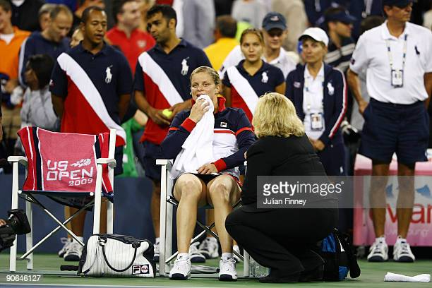 Kim Clijsters of Belgium sits after the Women's Singles Semifinal match in which Serena Williams was disqualified for a conduct violation towards a...
