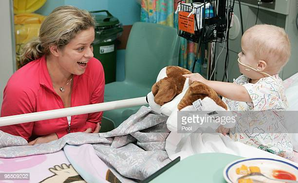 Kim Clijsters of Belgium smiles at a young patient while on a visit to the Royal Brisbane Childrens Hospital on December 31 2009 in Brisbane...