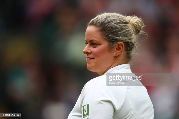 Kim Clijsters of Belgium smiles during the mixed doubles match between John McEnroe of the United States and his partner Kim Clijsters of Belgium and...
