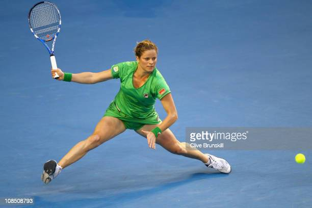 Kim Clijsters of Belgium stretches for a forehand in her women's final match against Na Li of China during day thirteen of the 2011 Australian Open...