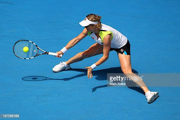 Kim Clijsters of Belgium stretches to play a forehand in her second round match against Stephanie Foretz Gacon of France during day three of the 2012...
