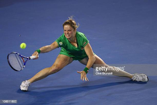 Kim Clijsters of Belgium stretches to play a forehand in her women's final match against Na Li of China during day thirteen of the 2011 Australian...
