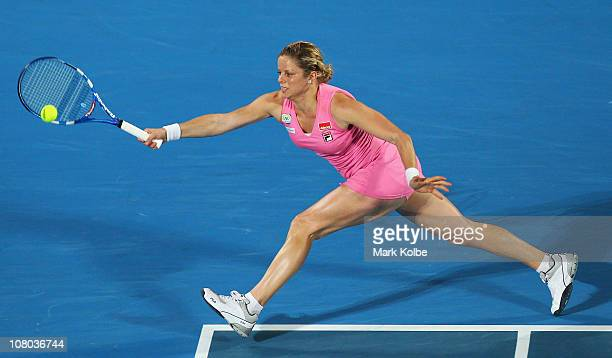 Kim Clijsters of Belgium stretches to play a forehand in the women's final against Na Li of China during day six of the 2011 Medibank International...