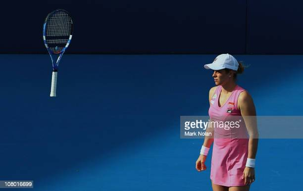 Kim Clijsters of Belgium throws her racket in her match against Alisa Kleybanova of Russia during day five of the 2011 Medibank International at...
