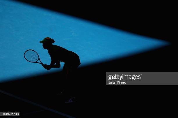 Kim Clijsters of Belgium waits to return serve in her semifinal match against Vera Zvonareva of Russia during day eleven of the 2011 Australian Open...