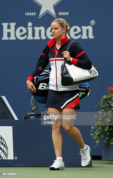 Kim Clijsters of Belgium walks on the court before her match against Viktoriya Kutuzova of Ukraine during day one of the 2009 US Open at the USTA...