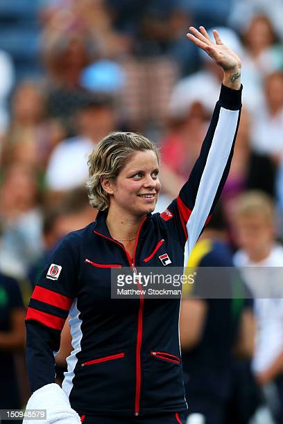 Kim Clijsters of Belgium waves to the crowd before walking off court following her defeat to Laura Robson of Great Britain after their women's...