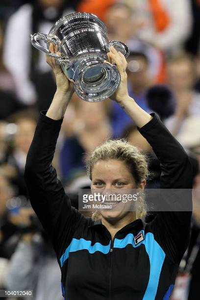 Kim Clijsters of Belguim celebrates with the trophy after defeating Vera Zvonareva of Russia during their women's singles final on day thirteen of...