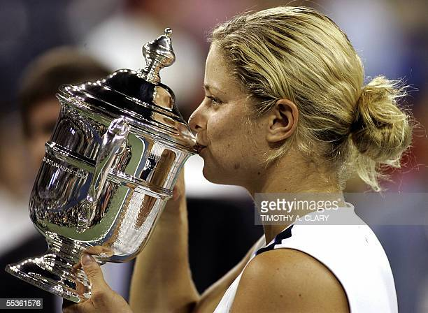 Kim Clijsters of Belguim holds her trophy after defeating Mary Pierce of France in the Woman's Final at the 2005 US Open Tennis Championships 10...