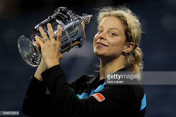 Kim Clijsters of Belguim kisses with the trophy in celebration of her win over Vera Zvonareva of Russia during their women's singles final on day...