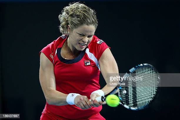 Kim Clijsters of Belguim plays a backhand against Iveta Benesova of the Czech Republic during day five of the 2012 Brisbane International at Pat...