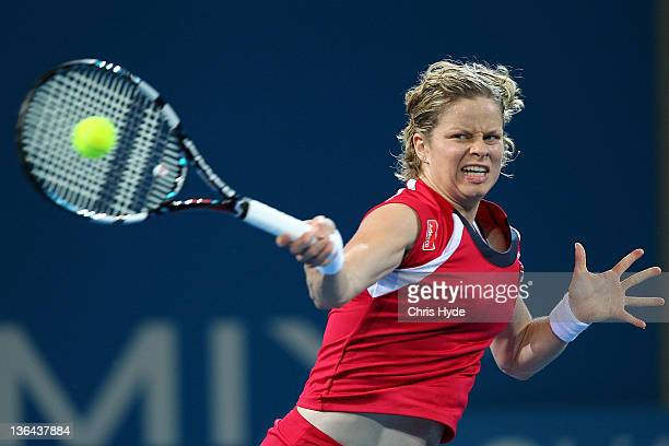 Kim Clijsters of Belguim plays a forehand against Iveta Benesova of the Czech Republic during day five of the 2012 Brisbane International at Pat...