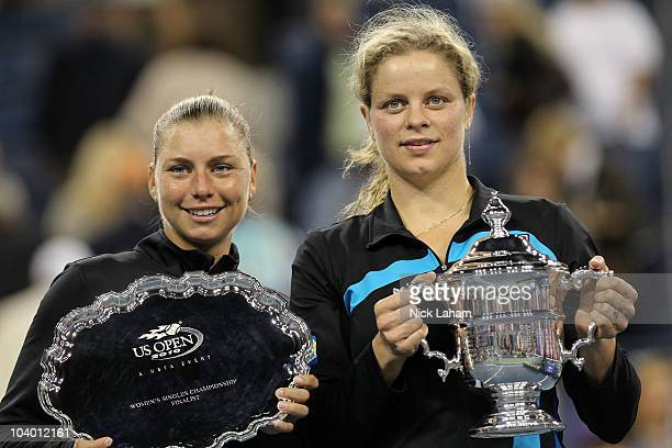 Kim Clijsters of Belguim poses with the first place trophy alongside Vera Zvonareva of Russia who poses with the second place trophy after their...