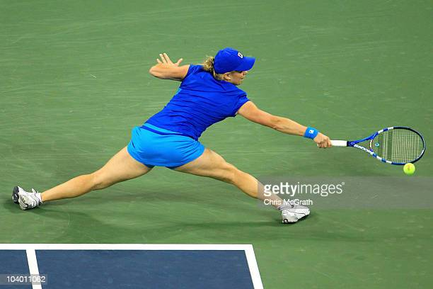 Kim Clijsters of Belguim returns a shot against Vera Zvonareva of Russia during her women's singles final on day thirteen of the 2010 US Open at the...