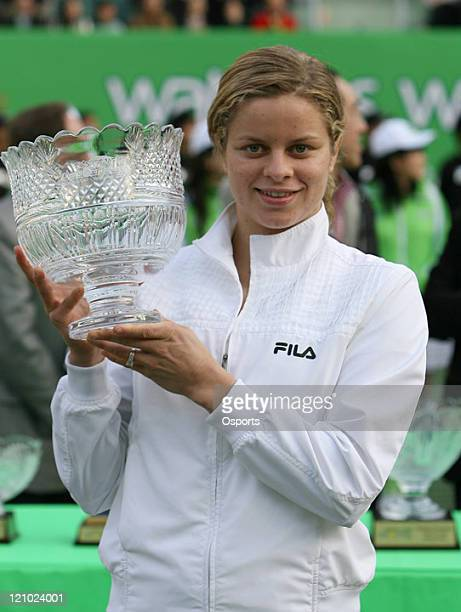 Kim Clijsters poses with the trophy after winning the match against Maria Sharapova at the WTA Watsons Water Champions Challenge 2007 Gold Group...