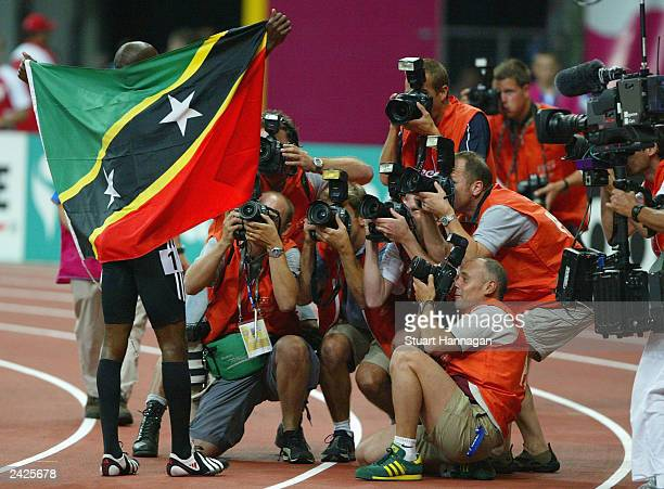 Kim Collins of St Kitts and Nevis poses for photographers after he won the men's 100m final at the 9th IAAF World Athletics Championship August 25...