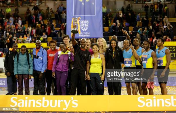 Kim Collins of the Commonwealth lifts the trophy during the British Athletics Sainsbury's Glasgow International Match at the Emirates Arena on...