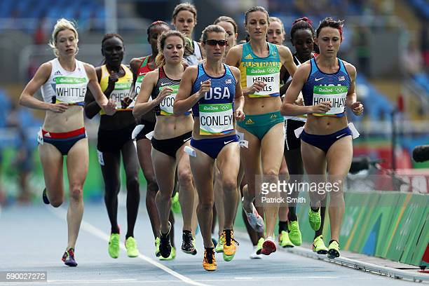 Kim Conley and Shelby Houlihan of the United States lead the pack during the Women's 5000m Round 1 - Heat 1 on Day 11 of the Rio 2016 Olympic Games...