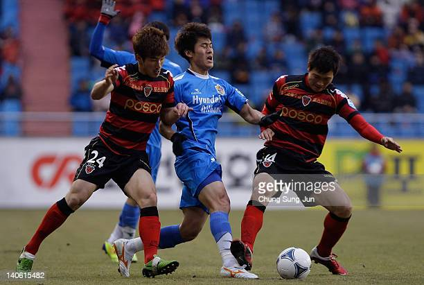Kim DaeHo of Pohang Steelers and Lee Yong of Ulsan Hyundai compete for the ball during the KLeague match between Pohang Steelers and Ulsan Hyundai at...
