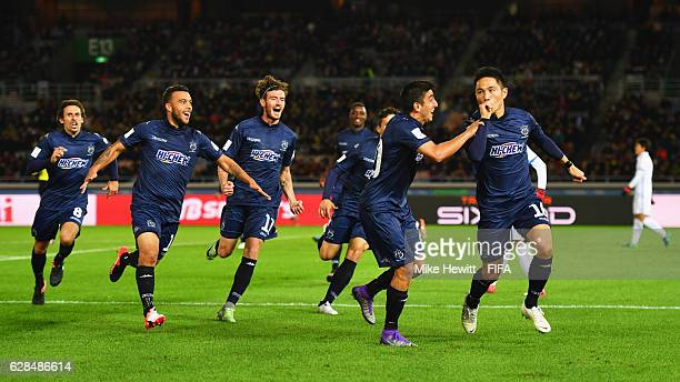 Kim DaeWook of Auckland City celebrates with team mates as he scores their first goal during the FIFA Club World Cup Playoff for Quarter Final match...