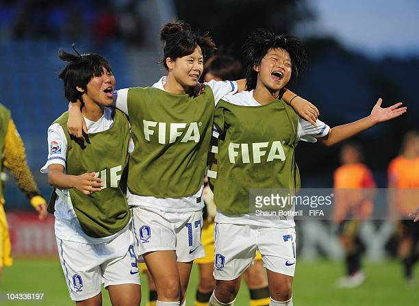 Kim Dahye Lee Yoo Na and Kim Nari of South Korea celebrate after beating Spain at the end of the FIFA U17 Women's World Cup Semi Final match between...