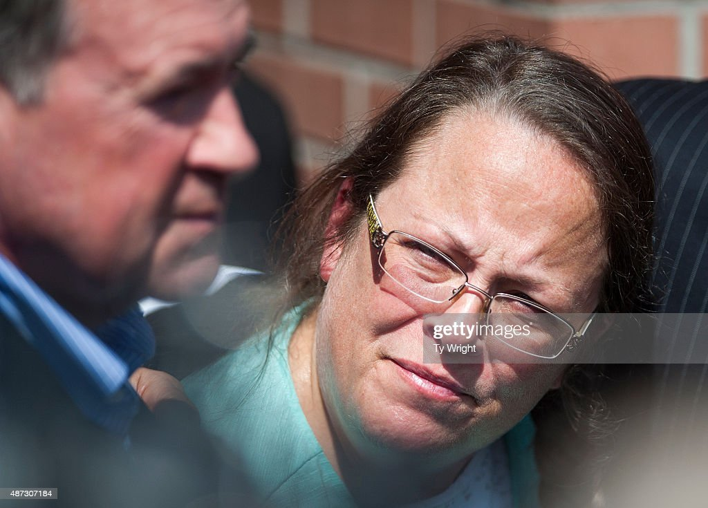 Kim Davis, Clerk of Courts in Rowan County, Kentucky, looks over at Mike Huckabee after she was released from six days of incarceration at the Carter County Detention Center on September 8, 2015 in Grayson, Kentucky. Davis was ordered to jail last week for contempt of court after refusing a court order to issue marriage licenses to same-sex couples.
