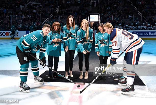 Kim Davis Hannah Gordon Kristi Yamaguchi and Annie Pankowski drop the puck in front of Logan Couture of the San Jose Sharks and Connor McDavid of the...