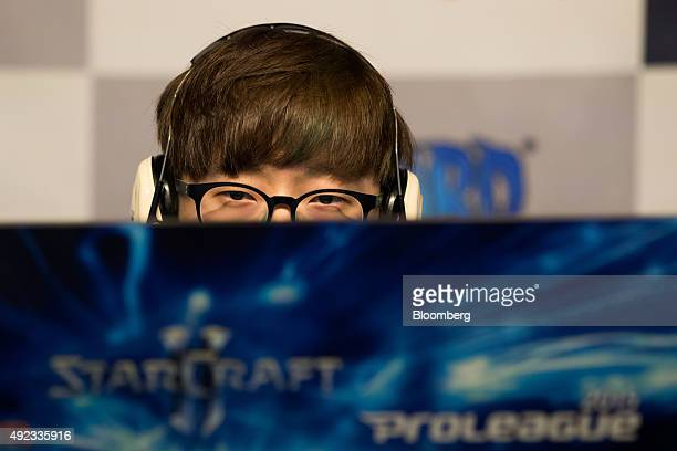 Kim Doh Wook a gamer of the Jin Air Green Wings professional videogame team sponsored by Korean Air Lines Co's Jin Air Co competes during the second...