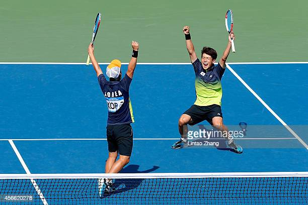 Kim Donghoon and Kim Beomjun of South Korea celebrate winning the Soft Tennis Men's Team Gold Medal Match competes against Hidenori Shinohara and...