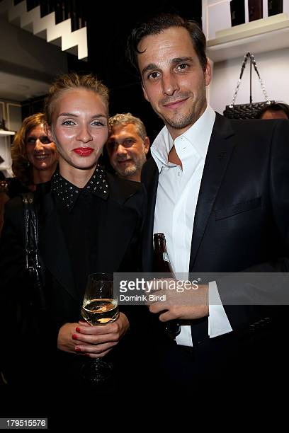Kim Eberle and Max von Thun Hohenstein attend the Karl Lagerfeld store opening on September 4 2013 in Munich Germany