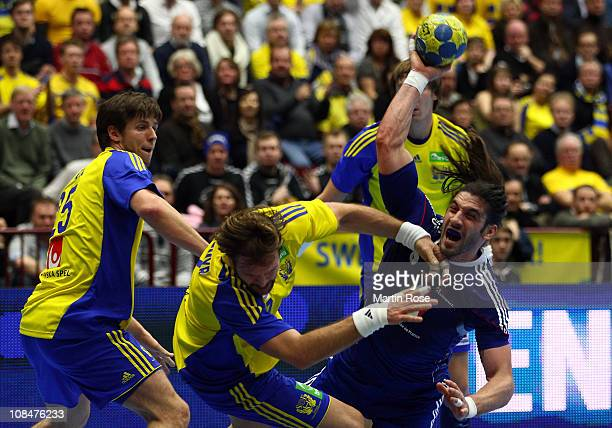 Kim Ekdahl and Magnus Jernemyr of Sweden are challenged by bertrand Gillle of France during the Men's Handball World Championship semi final match...
