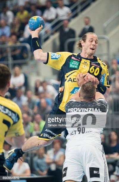 Kim Ekdahl du Rietz of RheinNeckar Loewen is challenged by Christian Zeitz of Kiel during the DKB HBL match between RheinNeckar Loewen and THW Kiel...