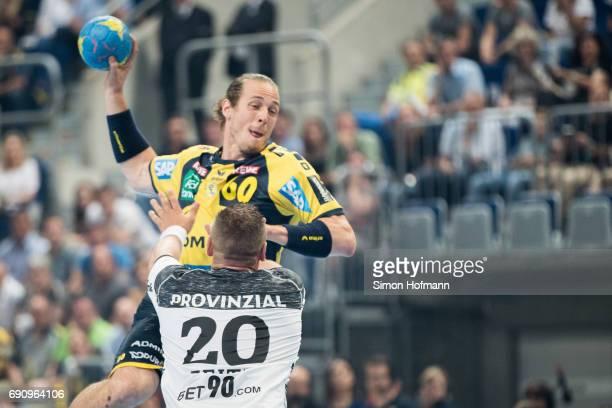 Kim Ekdahl du Rietz of RheinNeckar Loewen tries to score against Christian Zeitz of Kiel during the DKB HBL match between RheinNeckar Loewen and THW...