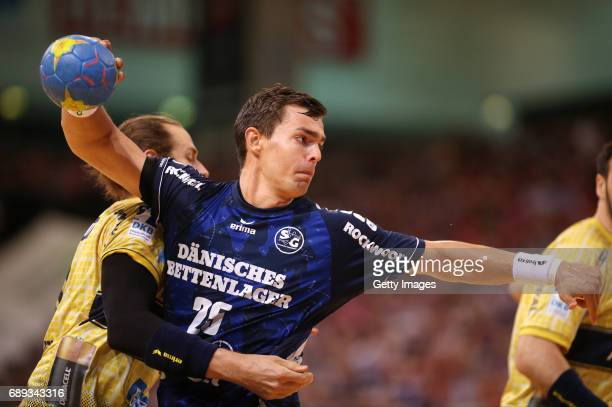 Kim Ekdahl Du Rietz of RheinNeckarLoewen fights for the ball with Rasmus Lauge of SG Flensburg Handewitt at FlensArena on May 28 2017 in Flensburg...