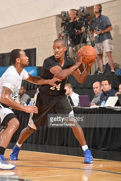 Kim English of the Detroit Pistons protects the ball during the 2013 Southwest Airlines Orlando Pro Summer League game between the Detroit Pistons...