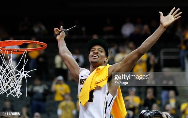 Kim English of the Missouri Tigers celebrates while cutting down the net after defeating the Baylor Bears to win the Big 12 Basketball Tournament...