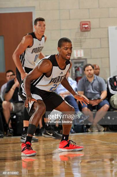Kim English of the Orlando Magic defends against the Houston Rockets during the Samsung NBA Summer League 2014 on July 7 2014 at Amway Center in...