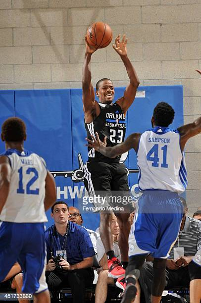 Kim English of the Orlando Magic passes the ball against the Philadelphia 76ers during the Samsung NBA Summer League 2014 on July 5 2014 at Amway...