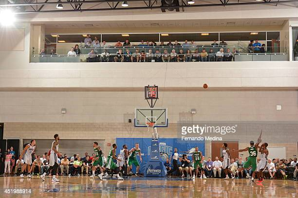 Kim English of the Orlando Magic shoots the ball against Marcus Smart of the Boston Celtics during the Samsung NBA Summer League 2014 on July 10 2014...
