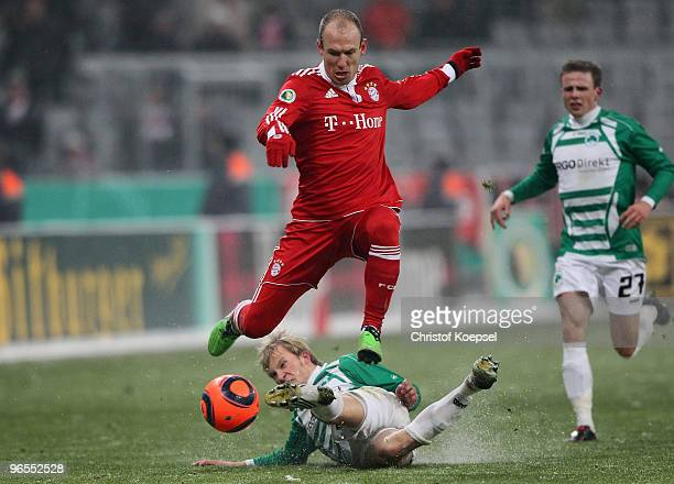Kim Falkenberg of Fuerth tackles Arjen Robben of Bayern during the DFB Cup quarter final match between FC Bayern Muenchen and SpVgg Greuther Fuerth...