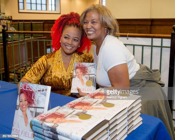 Kim Fields and Lisa Simon attend Kim Fields new book signing 'Blessed Life' at Barnes Noble on December 23 2017 in Atlanta Georgia