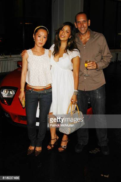 Kim Figuerola Sylvie Cachay and Michael Pozner attend Valentino hosts Runway Meets The Raceway at Classic Car Club Manhattan NYC on July 24 2006