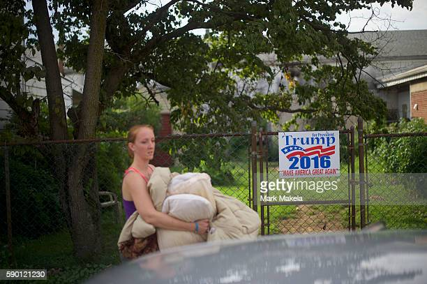 Kim Foss passes by a Republican Presidential candidate Donald Trump sign as she packs up her car on August 14 2016 in Schuylkill Haven Pennsylvania...