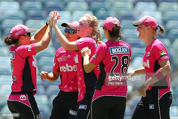 Kim Garth of the Sixers celebrates the wicket of Nicole Bolton of the Scorchers during the Women's Big Bash League match between the Perth Scorchers...
