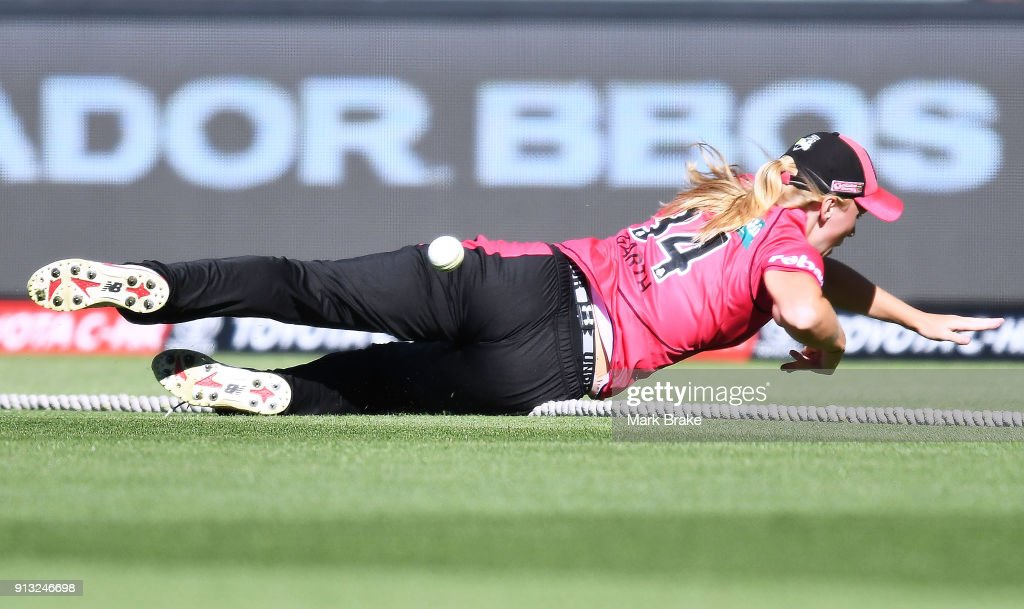 Kim Garth of the Sydney Sixers saves a four during the Women's Big Bash League match between the Adelaide Strikers and the Sydney Sixers at Adelaide Oval on February 2, 2018 in Adelaide, Australia.