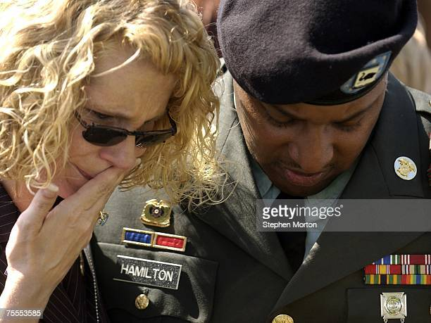 Kim Geonnotti of Clayton, New Jersey is comforted by Sgt. Arthur Hamilton during a memorial service at Warrior's Walk for her son Pfc. David J. Bentz...