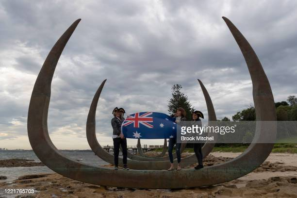 Kim Gilmore Calliegh Holland and Sarah Dawson wave the Australian flag at a new installation at the site Lieutenant James Cook is believed to have...