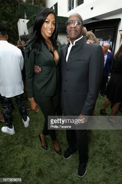 Kim Glass and Edwin Moses attend The 6th Annual Gold Meets Golden Brunch hosted by Nicole Kidman and Nadia Comaneci and presented by CocaCola at The...